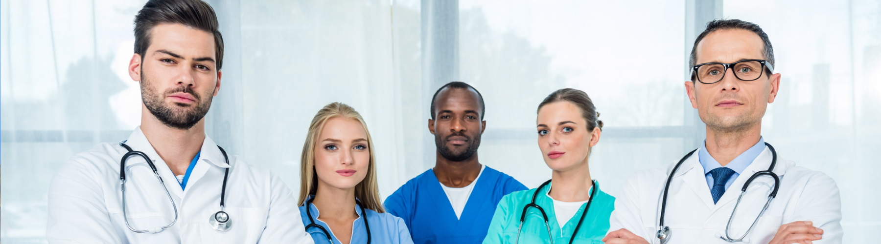 Group of medical professionals with arms crossed